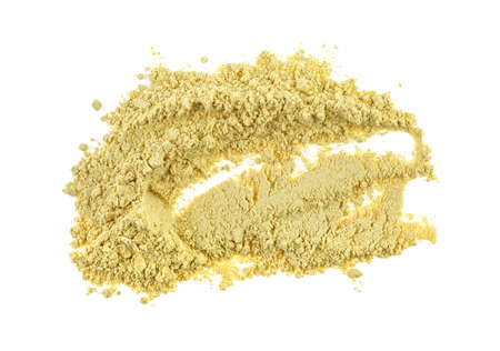 Heap of dried ginger powder isolated on white background