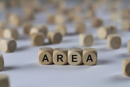 area - cube with letters, sign with wooden cubes