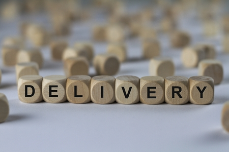 delivery - cube with letters, sign with wooden cubes