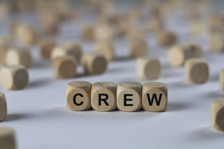 crew - cube with letters, sign with wooden cubes
