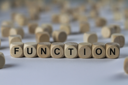 function - cube with letters, sign with wooden cubes