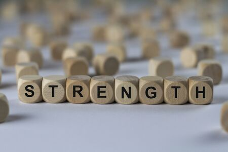 strength - cube with letters, sign with wooden cubes