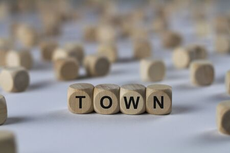 town - cube with letters, sign with wooden cubes