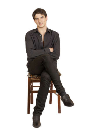 a young man sitting on a chair isolated on white background