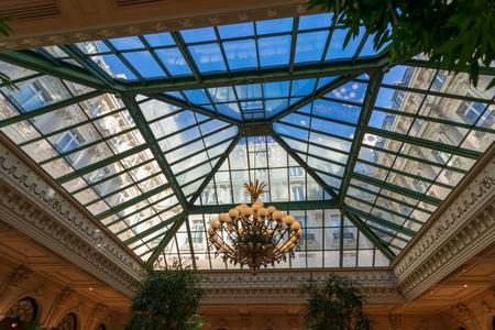 PARIS - SEPT 24, 2018: Famous historical Winter Garden at the Intercontinental Le Grand Hotel, Paris