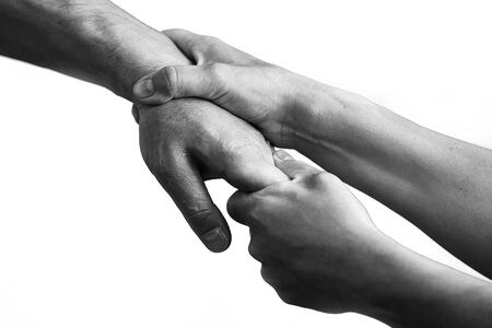 Photo for The wife holds her husbands hand, there are differences in the family. Bad relationships. Divorce, leaving the family - Royalty Free Image