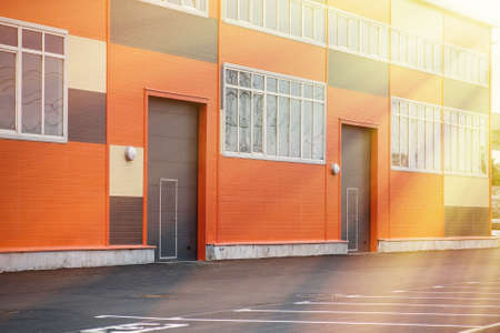 Photo for Warehouse building with lifting gates for entering trucks - Royalty Free Image