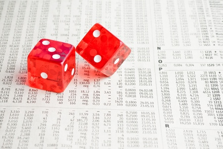 detail of two red dice on the financial newspaper