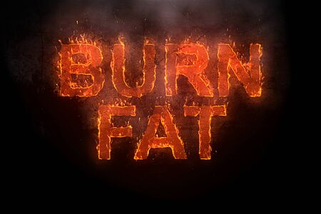 Photo for burn fat written with flames rising on a black background - Royalty Free Image