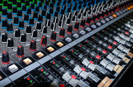 Photo for Professional audio studio sound mixer console board panel with recording - Royalty Free Image