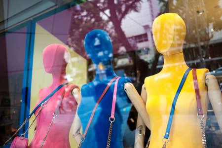 Female mannequins display inside a glass windowの写真素材
