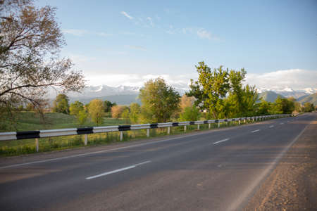 Photo for asphalt road to the village on the background of the mountain - Royalty Free Image