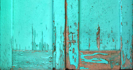 old worn wooden surface painted in turquoise blue with rough texture with scratches - aged door wallpaper background for a blog