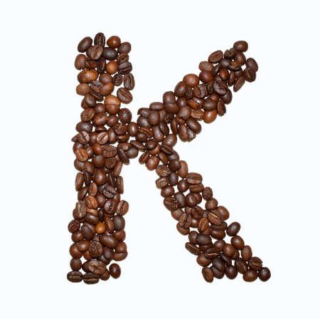 Foto de English Coffee Alphabet isolated on white. Roasted coffee beans. ?offee letter - K - Imagen libre de derechos