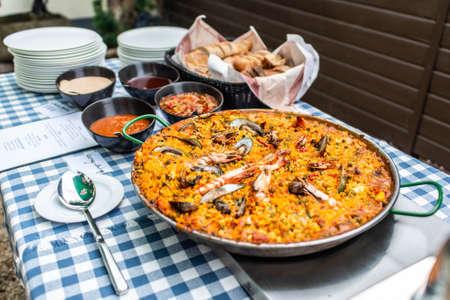 huge Paella pan plate with seafood and rice traditional Spanish food