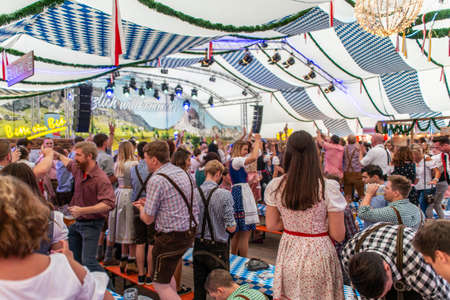 Koblenz Germany -26.09.2018 people party at Oktoberfest in europe during a concert Typical beer tent scene