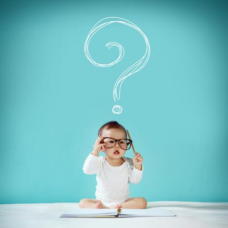 Photo pour Little baby have a question new family and love concept studio shot - image libre de droit