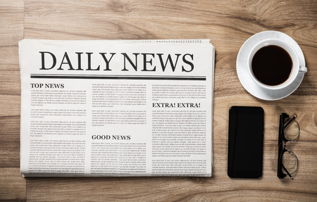 Photo pour Newspaper with the headline News and glasses and coffee cup on wooden table, Daily Newspaper mock-up concept - image libre de droit