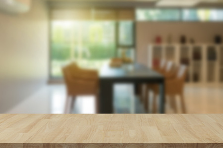 Photo for Empty wooden table top with view of office or wooden desk with library room with blur background, copy space for your text - Royalty Free Image