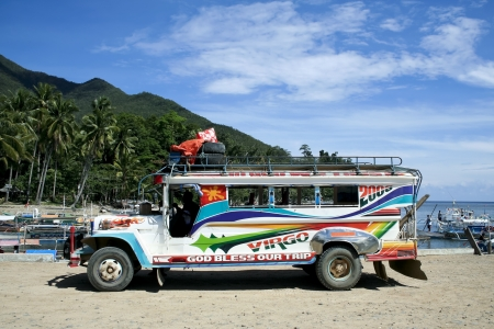local public transport in the philippines a colorful jeepney parked in sabang port, palawan iland in the philippines