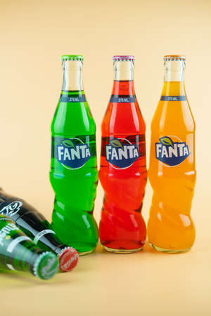 Photo pour Samut Prakan, Thailand - March 8, 2021 : Popular soft drink in glass bottle volume 375 ML. such as Coca-Cola, Fanta of three flavour and Sprite on a orange background - image libre de droit
