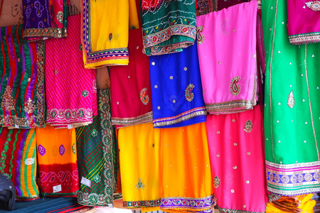 Display of colorful saris at Johari Bazaar in Jaipur, India. Jaipur is the capital and the biggest city of Rajasthan.