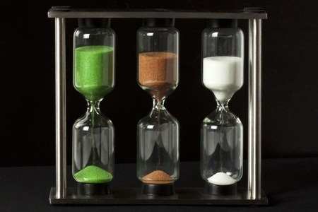 Three colour Hourglass on the black background
