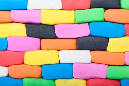 Colorful plasticine wall bricks extreme closeup