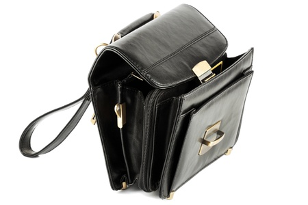 Opened Mans black leather business bag on the white background