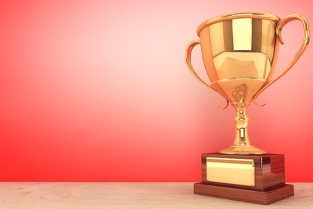 Champion gold cup trophy on a red background