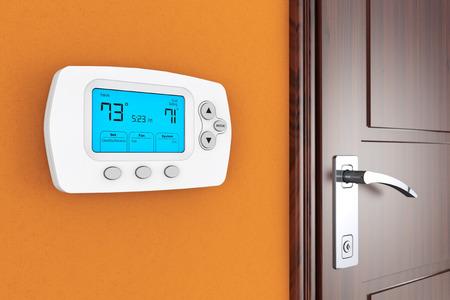 Modern Programming Thermostat on a wall near door