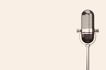 Vintage silver microphone on a white background