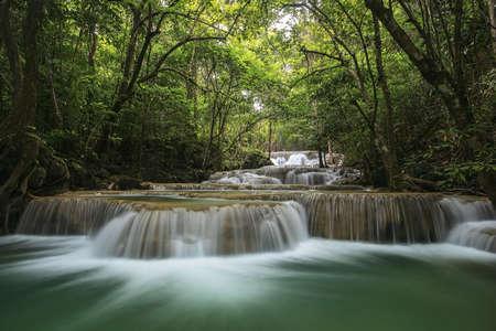 Foto de Water fall in spring season located in deep rain forest jungle  - Imagen libre de derechos