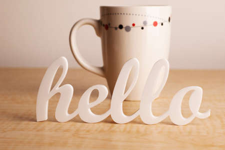 Hello in Front of Coffee Mug