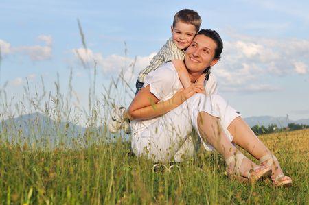 Foto de happy young woman mother play and outdoor with beautiful child  - Imagen libre de derechos