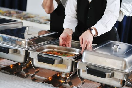 catering buffet food party preparation man