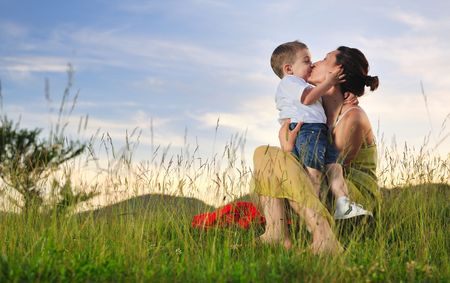 Photo pour happy young woman mother play and outdoor with beautiful child - image libre de droit