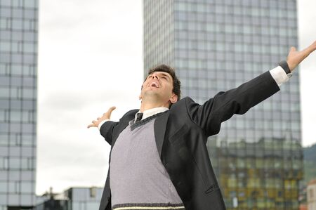 Outdoor portrait of young and happy  businessman