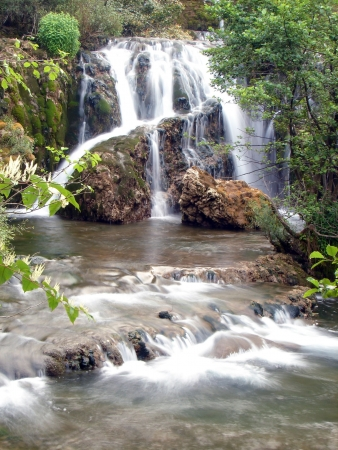Photo pour fresh water of clean wild river with waterfall in nature - image libre de droit
