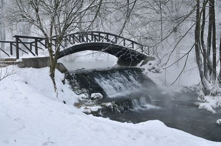 Photo for small wooden bridge over cold river at early mornig at winter season - Royalty Free Image