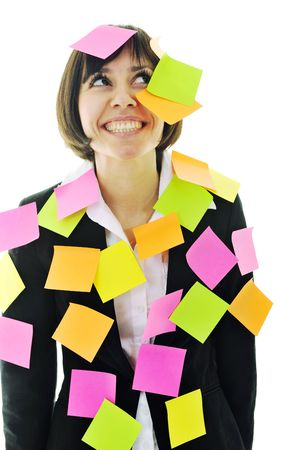 one frustrated young business woman with many of post it representing concept memory and frustration on work
