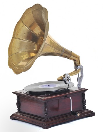 retro old gramophone for playing music over plates  isolated on white in studio