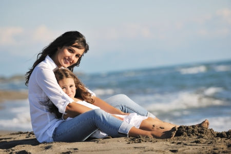 Photo for family portrait of young beautiful mom and daughter on beach - Royalty Free Image