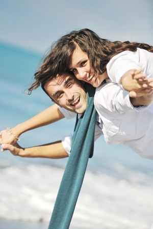 Foto de happy young couple in white clothing  have romantic recreation and   fun at beautiful beach on  vacations - Imagen libre de derechos