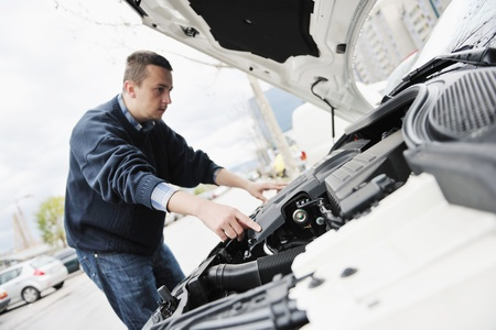 man looking at new car vihicle engine and try to find probelm at repair fix and maintanance service
