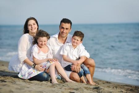 Foto de happy young family have fun and live healthy lifestyle on beach - Imagen libre de derechos