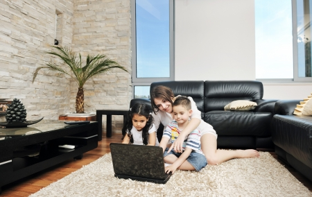 Photo pour happy young family have fun and working on laptop at modern  home livingroom indoor - image libre de droit