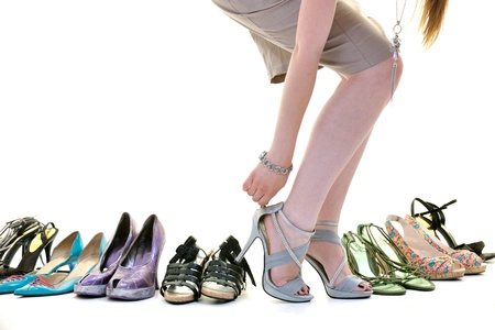 Foto de woman buy shoes concept of choice and shopping, isolated on white background in studio - Imagen libre de derechos