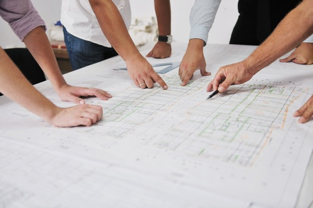 Photo pour Team of architects people in group  on construciton site check documents and business workflow - image libre de droit