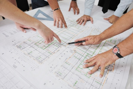 Photo for Team of architects people in group  on construciton site check documents and business workflow - Royalty Free Image